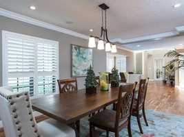 The large dining room with hutch niche will accommodate large dinner parties.