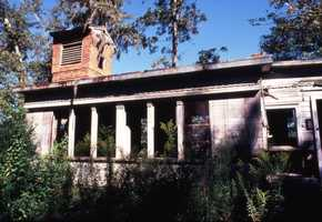 View of an abandoned house in the Tallahassee Downtown Improvement Authority special assessment district. (After 1971)
