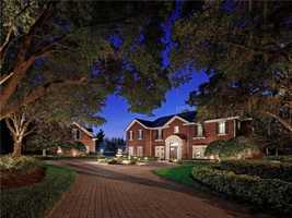 The one acre estate is surrounded by mature magnolia and oak trees.