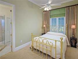 The five guest bedrooms in the home each have a private en suite bathroom.