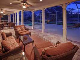 A shot of the pool area from the home's porch.