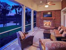 An outdoor fireplace is also part of the home's porch and overlooks the lake.