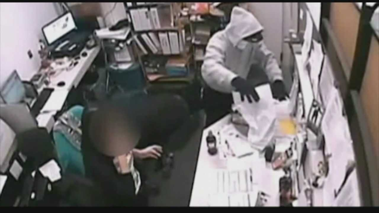 Orlando police are searching for the man who pulled a gun on workers at a College Park pharmacy early Sunday morning and forced them to the floor.