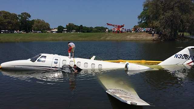 Three scramble to safety when jet rolls into pond