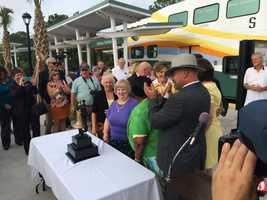 Local officials celebrated the grand opening of SunRail by riding the train from Debary to Sand Lake Road on Wednesday. SunRail officially opens on Thursday.