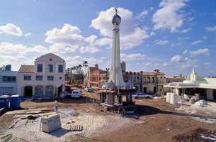 Mickey Mouse has been waving to every guest since the opening as he walks on top of the world. Here is a picture of the construction.