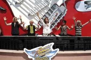 Aerosmith was on-hand for the opening of Rock 'N' Roller Coaster on July 29, 1999.