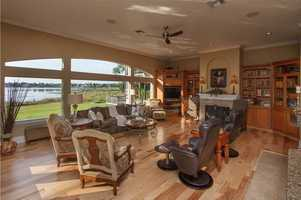 Panoramic views in this family room, which also boasts new wood floors and a beautiful fireplace.