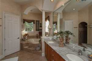 Luxurious master bathroom includes a spa tub.