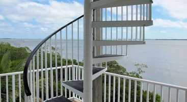 It includes a fully furnished custom Florida-style two-bedroom pool home.