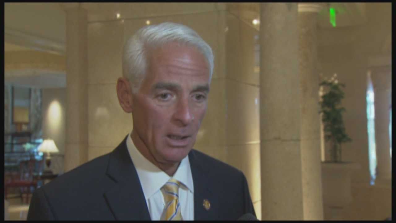 Former Gov. Charlie Crist is blaming Republican Gov. Rick Scott for being uninvited to speak at the Council of 100 policy advisory group's meeting.