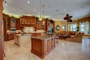 The kitchen and family room encompass an open layout.