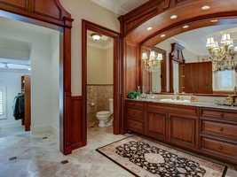 The master bathroom leads you to the impressive walk-in closet.