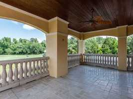 Spacious porch is directly overlooking the golf course and tennis court.