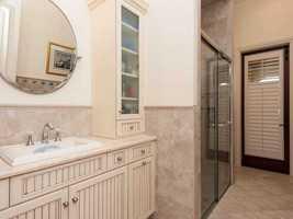 En suite full bathroom with tiled shower.