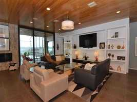 The family room faces the lake and features a minimalistic wall unit.