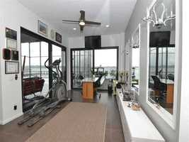Who wouldn't want to work out when you have this view? This home gym makes exercise both convenient and picturesque.