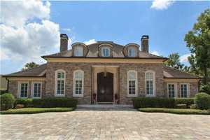 This estate delivers European elegance and lake house comfort. The property boasts six bedrooms, a private apartment and infinity pool overlooking Lake Maitland.