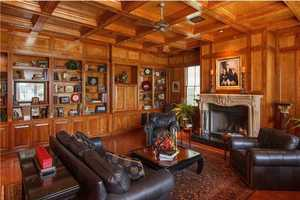 The paneled library.