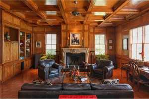 Fireplaces are located in the great room, the paneled library and the master suite.