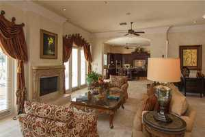 The kitchen also looks over into the elegant, yet comfortable, family room.