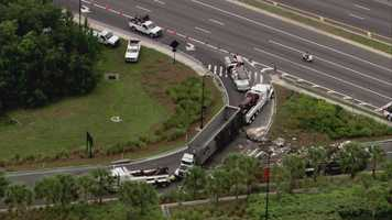 A dump truck overturned spilling trash on the eastbound entrance ramp to State Road 408 from northbound John Young Parkway on Monday morning.