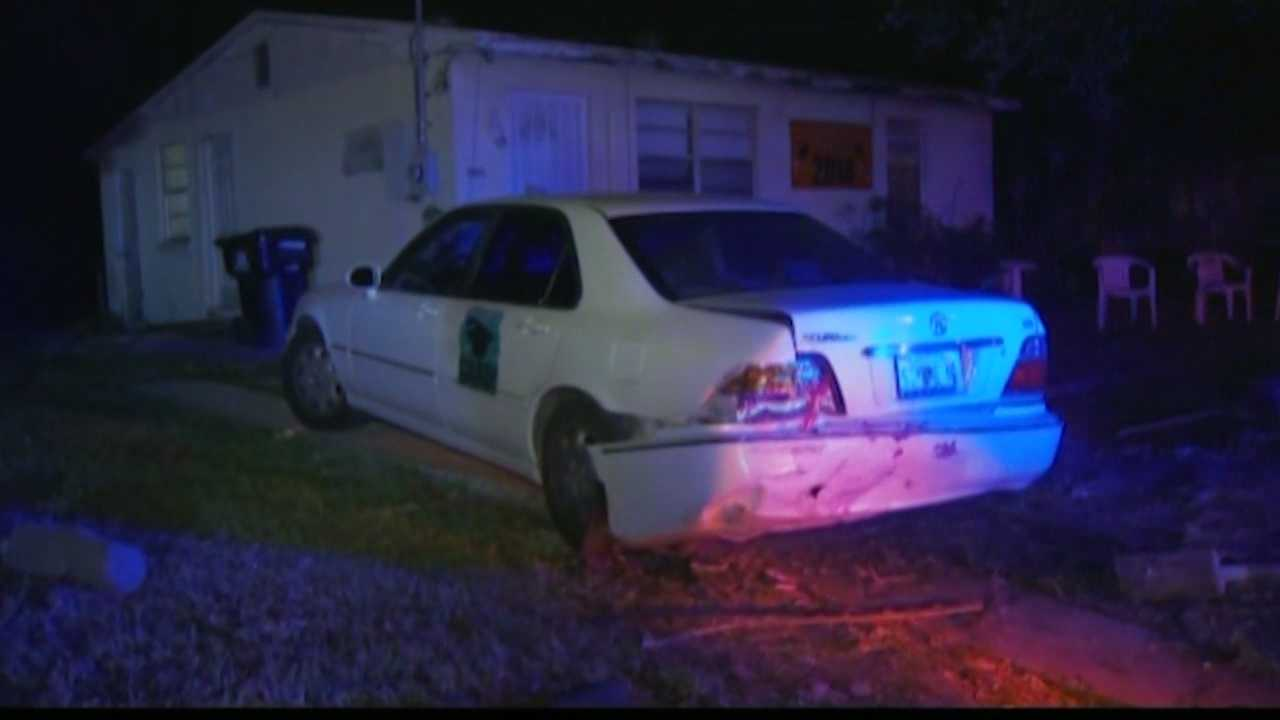 Orlando police said a car crashed through a fence, hit two parked cars and the driver tried to flee, but quick thinking neighbors held the man down.