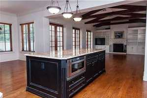 The kitchen/ family room exists in an open floor plan.