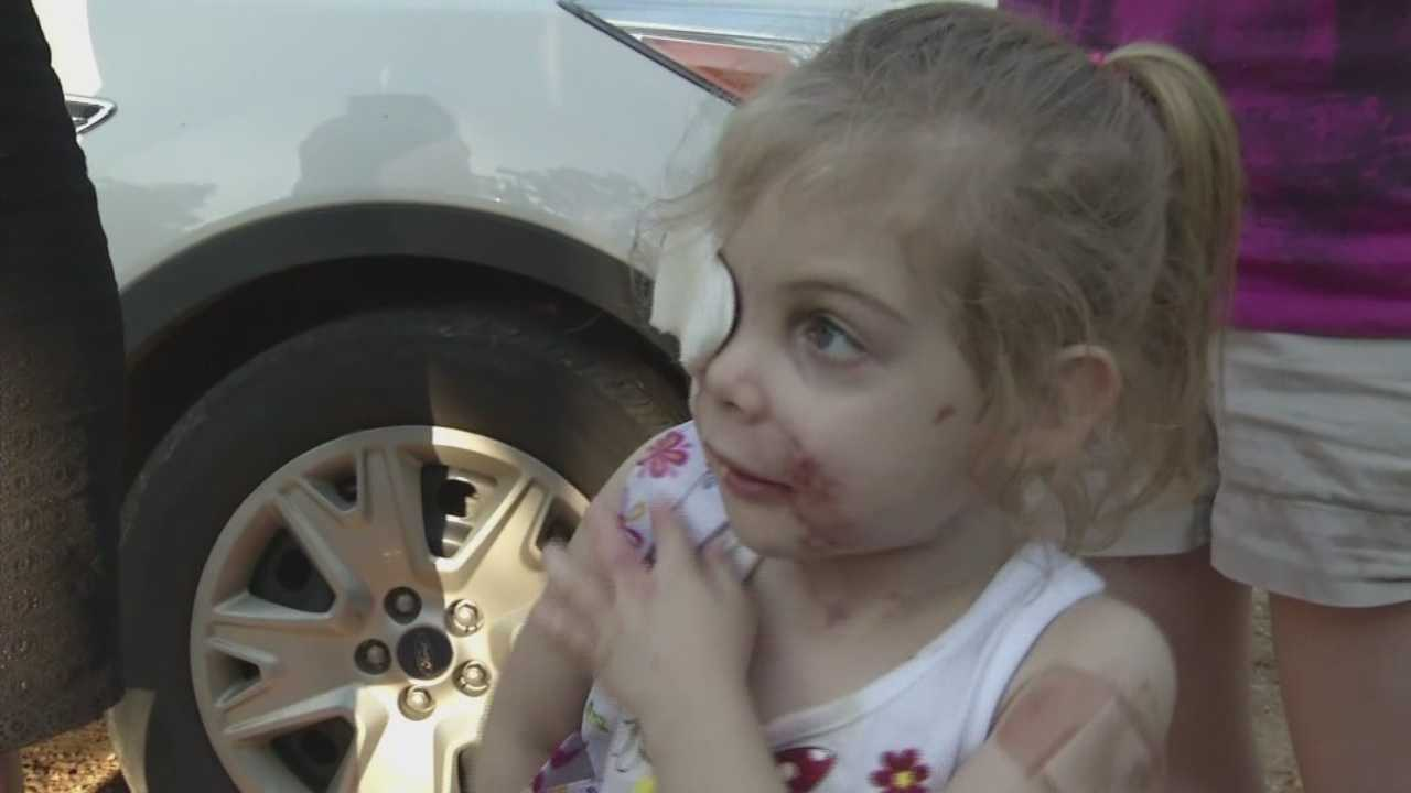 Executives at KFC are looking into claims a toddler was kicked out of one of their restaurants because of how she looks.