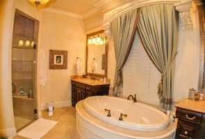Master bathroom features a generous oval tub.
