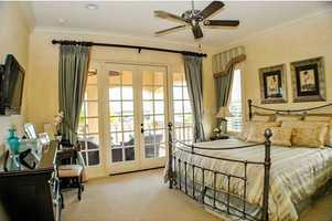 This bedroom has access to the second floor balcony.