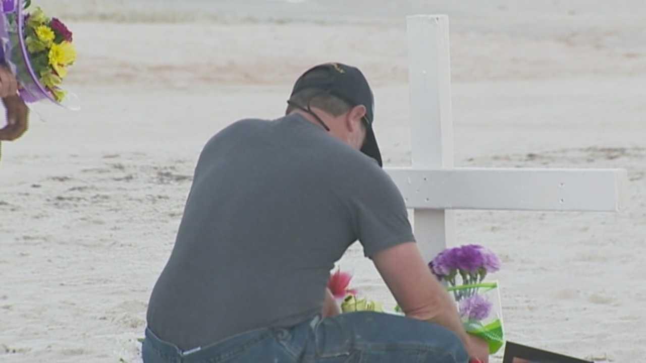 Vigil held for woman fatally struck on beach