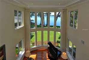 Floor-to-ceiling windows offer spectacular views of Lake Maitland.