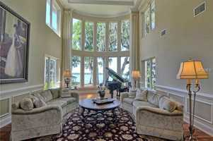 The formal living room boasts 20 ft. ceilings.