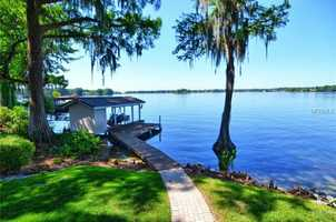 Private boat dock and lift make this home perfect for entertaining or family living!