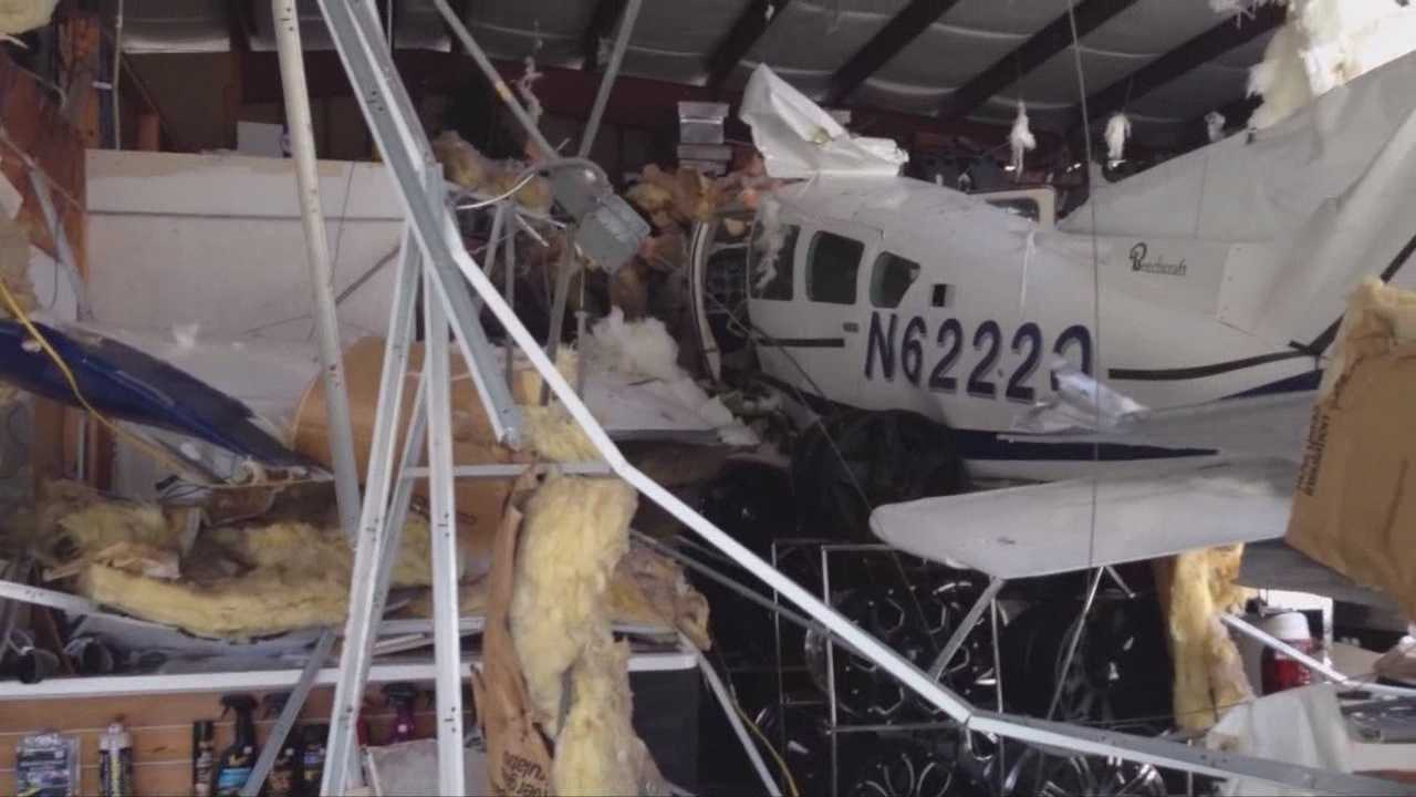 Plane crashes into Titusville collision repair shop roof