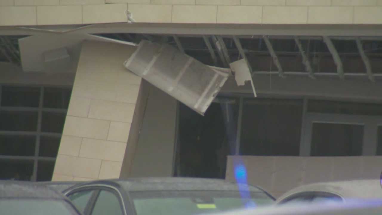 Roof collapses at car dealership