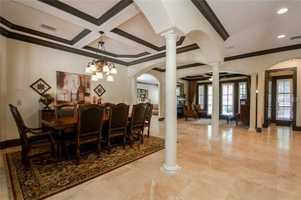 Formal dining room exists within an elegant, open-floor plan.