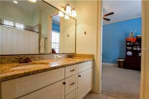 The bedroom includes an en suite bathroom.