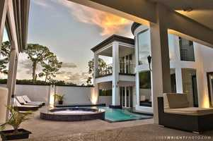 From this view, you can see the luxurious outdoor space includes a covered lanais.
