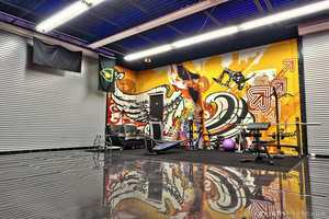 This side of the extravagant garage has been converted into an energized work out space.