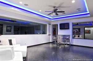 Above the garage is a tasteful lounge, suitable for a man-cave.