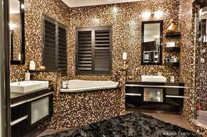Spectacular tile pattern in the master bathroom, which also boasts a spa tub.
