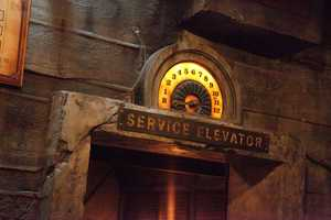 2. The ride vehicle is an elevator car.