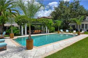 This is more than a backyard---it has exquisite landscaping around the pool.