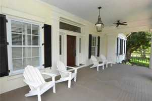 This lovely porch completes the Florida estate perfectly.For more information on this property, visit Realtor.com .