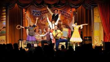 """""""Hoop-Dee-Doo Musical Revue"""" at Disney's Fort Wilderness Resort & Campground Pioneer Hall offers a down-home musical and comical revue with all-you-can-eat barbecue ribs, fried chicken, corn on the cob, strawberry shortcake and beverages.The show times are at 4, 6:15 and 8:30 nightly. Prices are $65.99, $58.99 and $54.99 for ages 10 and under."""