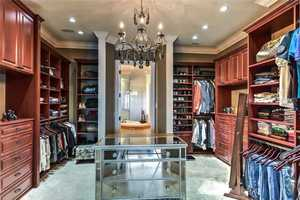 Master suite includes a large walk-in closet and dressing room.