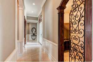 Hallways feature marble tile as well.