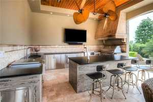Outdoor living at its finest with an expansive and fully-equipped Summer Kitchen.